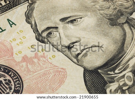 A sad president Hamilton with tears on the ten dollar bill. Represent the bad state of the economy - stock photo