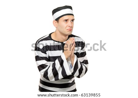 A sad prisoner with both hands clasp in begging gesture against white background - stock photo