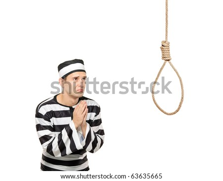 A sad prisoner with both hands clasp in begging gesture with a hanging noose against white background - stock photo