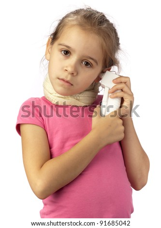 A sad sick girl with thermometer measures the temperature in the ear on a white background