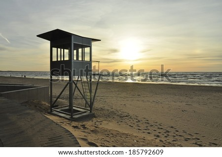 A safeguard post on the beach with the view on the sea sunset - stock photo