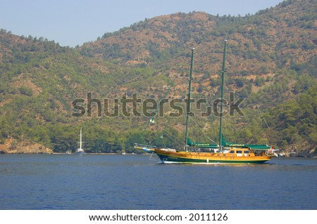 a sail boat in a bay in turkey - stock photo