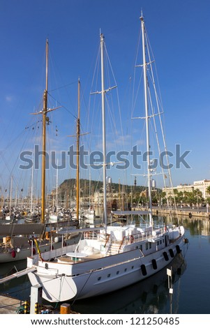 A sailboat at Port Vell in Barcelona - stock photo