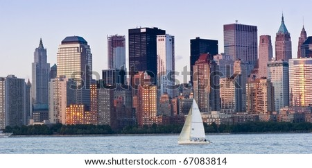 A sailboat in front of the majestic New York City Skyline. Useful as a concept photograph of New York. - stock photo