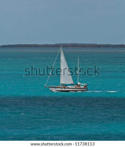 A sailboat in the Key West harbor - stock photo