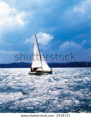 A sailboat in the sea - stock photo