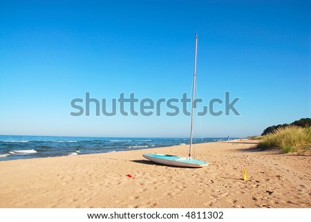 A sailboat on the beach at Lake Michigan, USA, in the summertime.