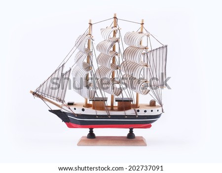 A sailboat vintage model isolated on white background - stock photo