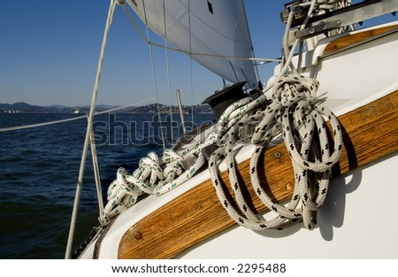 A sailboat with rope and winch. - stock photo