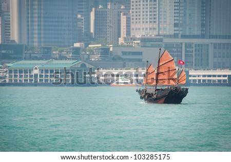 A sailing junkboat in hong kong - stock photo