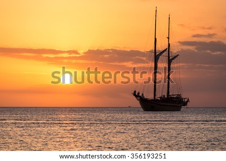 A sailing ship on the Andaman sea during an amazing sunset in Phuket - stock photo
