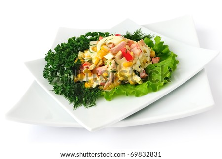 a salad of corn, Chinese cabbage, egg, ham, peppers and mayonnaise - stock photo