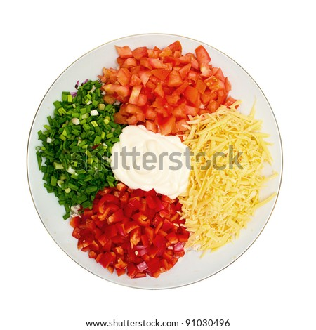 A salad of tomatoes, peppers, cheese, onions and mayonnaise - stock photo