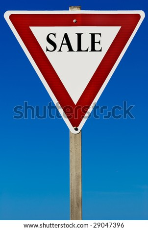 A sale sign isolated on a blue graduated sky.