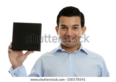 A salesman, businessman, teacher or other occupation holding a product, book or other merchandise in one hand and smiling.  White background. - stock photo