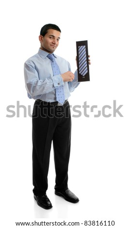 A salesman holding or presenting a mens silk tie or other boxed product.  White background. - stock photo