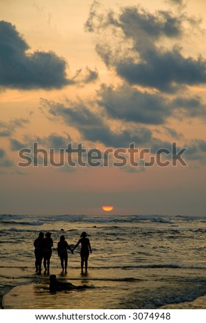 A salt water pool at high tide makes it look like people are walking on water. - stock photo