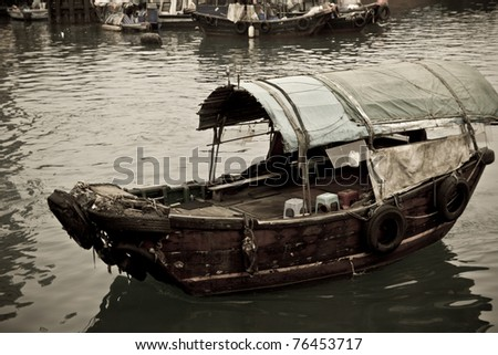 A Sampan boat floating in the sea in Hong Kong Typhoon Shelter