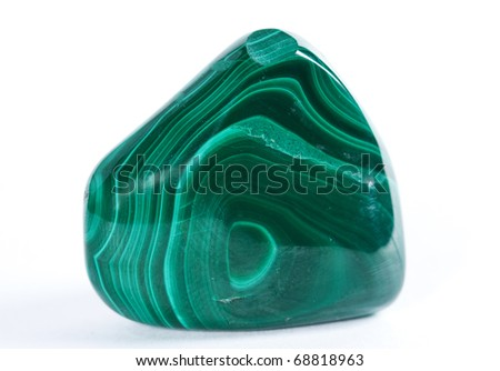 A sample of the mineral malachite on a white background - stock photo