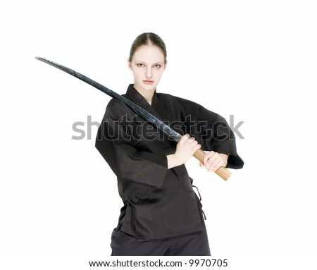 a samurai girl holding in her hands a katana - stock photo