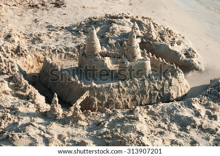 A sand castle at the beach - stock photo
