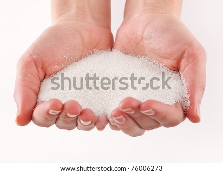 A sand in the hands. Isolated on a white background - stock photo