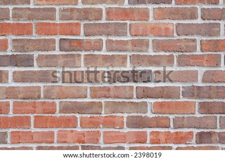 A sand textured brick wall - stock photo