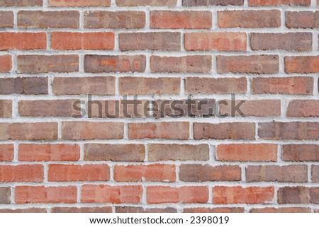 A sand textured brick wall - stock photo