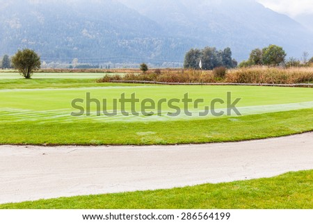 a sand trap bunker in a beautiful golf course - stock photo