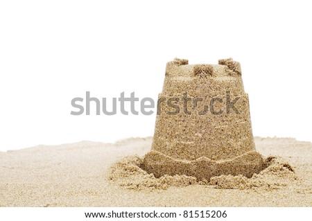 a sandcastle on the sand on a white background - stock photo