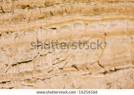 a sandstone pastel colored cliff background - stock photo