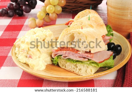 A sandwich with Italian cold cuts on ciabatta bread