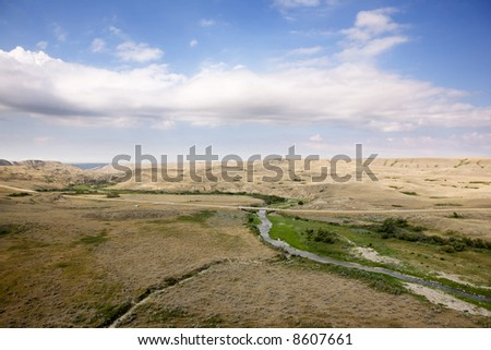 A saskatcheawn landscape in creek hills - stock photo