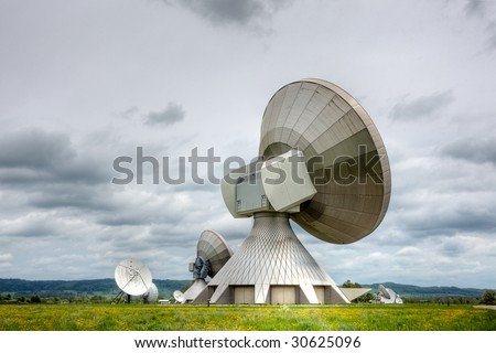 A satellite communications installation in a country setting. Poor weather. - stock photo