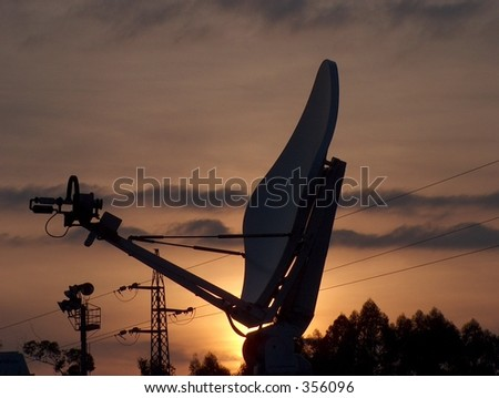 A Satellite Dish at sunset - stock photo