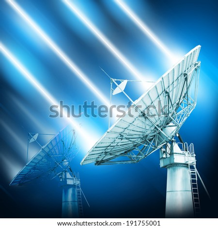 A satellite dish is a dish-shaped type of parabolic antenna designed to receive microwaves from communications satellites, which transmit data transmissions or broadcasts, such as satellite television - stock photo