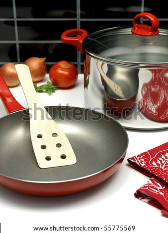 A saucepan and a frying pan on a kitchen bench - stock photo