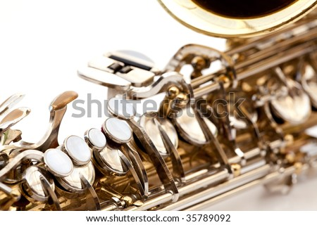 A saxophone detail isolated on white - stock photo