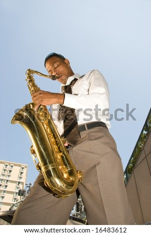 A saxophone player shows off his talents during a lunchtime presentation.