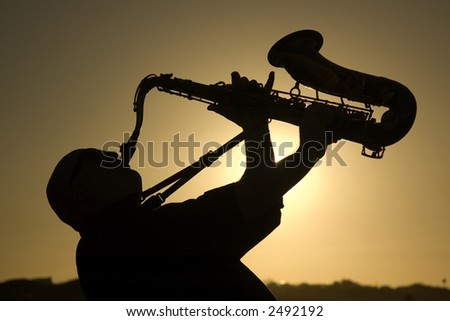A saxophonist playing on the beach in Famara in Lanzarote