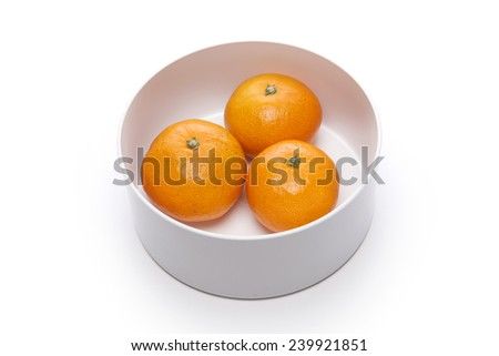 A scale for food and tape measure(tapeline) and mandarin(tangerine) and dumbbells for health and diet isolated white at the studio. - stock photo