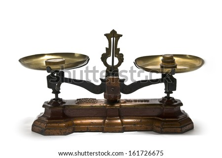 A scale with coins on one side and weight on the other. - stock photo