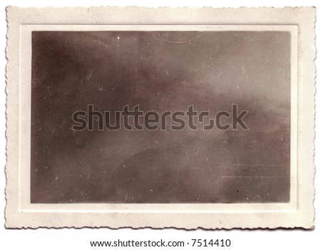 A scallop-edged vintage photograph.  The portrait has been removed, leaving only the texture to allow the easy insertion of any image using the multiply blend mode. - stock photo