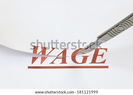 A scalpel cutting through the word Wage. Concept denoting a wage or salary cut, or reduced income because of a falling economy. - stock photo
