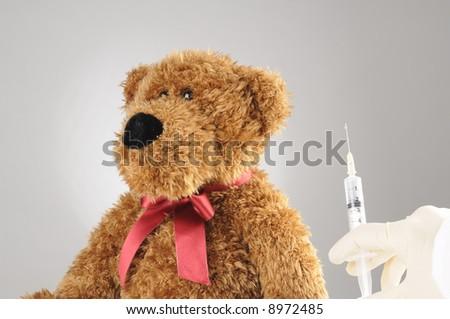 a scared teddy bear at the hospital - stock photo