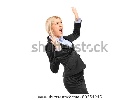 A scared young businesswoman shouting isolated on white background - stock photo