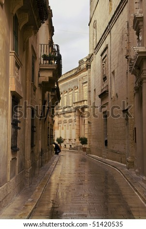 A scary figure on a deserted street - stock photo