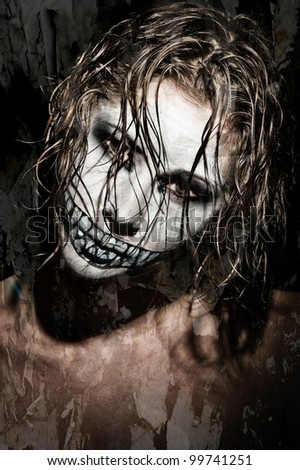 a scary looking girl with face paint - stock photo