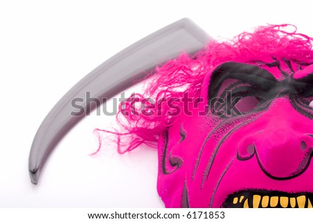 A scary mask and a scythe blade - stock photo