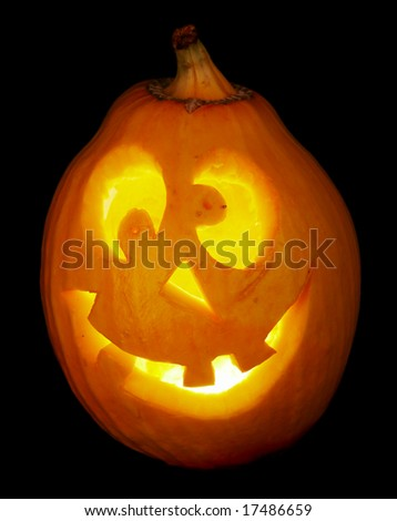 A scary old jack-o-lantern on black... - stock photo